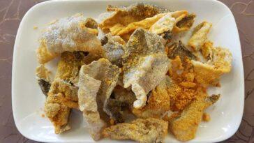 White dish full of fried fish skins
